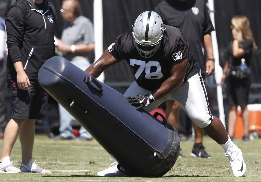 The Oakland Raiders defensive tackle Justin Ellis hits the tackling dummy during the second day of teams practice at Raiders Napa Valley training complex in Napa., Calif., on Sunday, July 30, 2017 ...