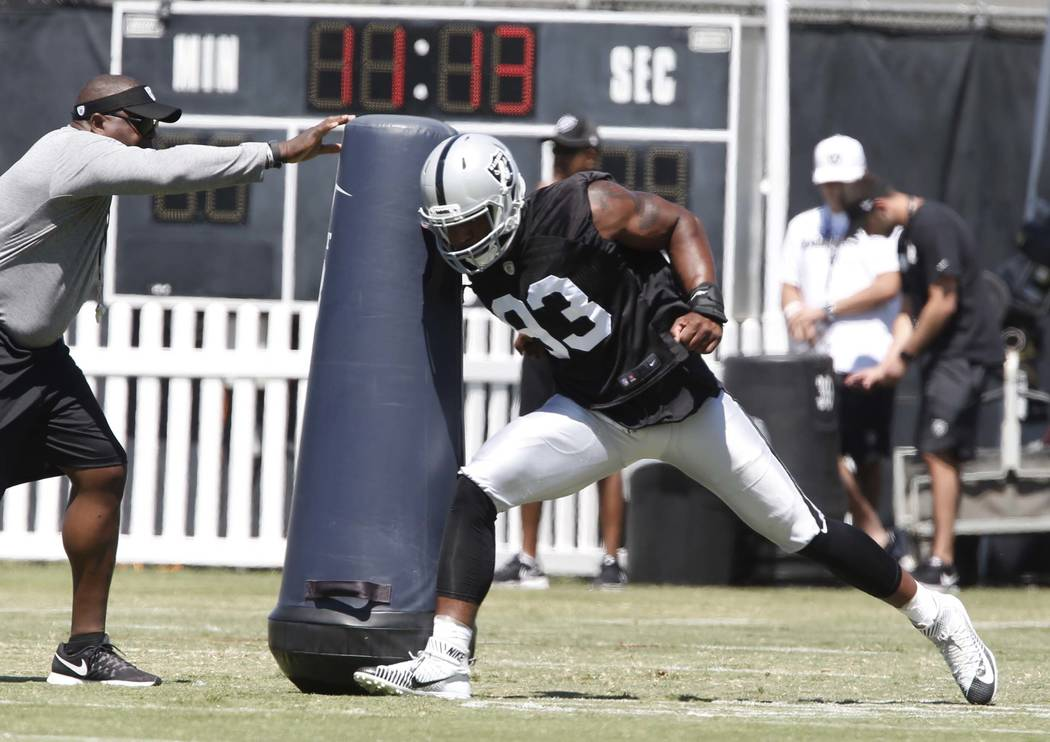 The Oakland Raiders defensive end Jimmy Bean hits the tackling dummy during the second day of teams practice at Raiders Napa Valley training complex in Napa., Calif., on Sunday, July 30, 2017. Biz ...