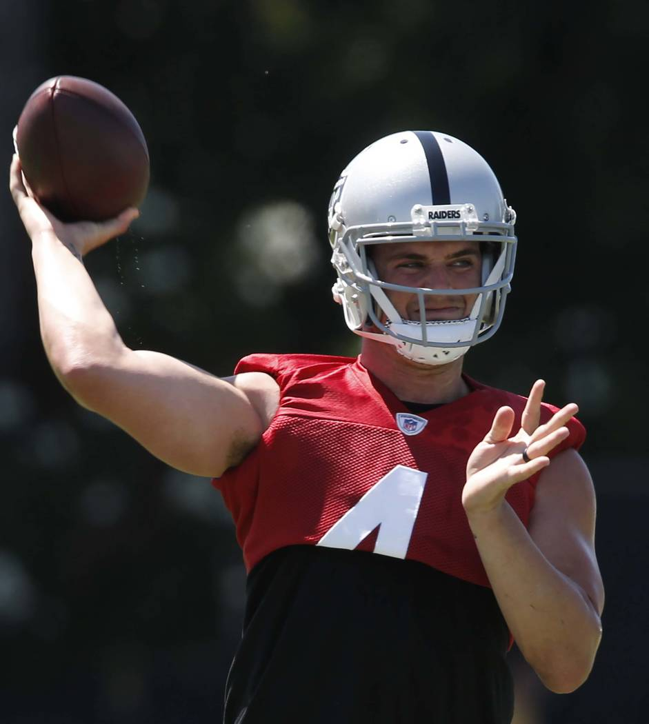 The Oakland Raiders quarterback Derek Carr prepares to pass the ball during the second day of teams practice at Raiders Napa Valley training complex in Napa., Calif., on Sunday, July 30, 2017. Biz ...