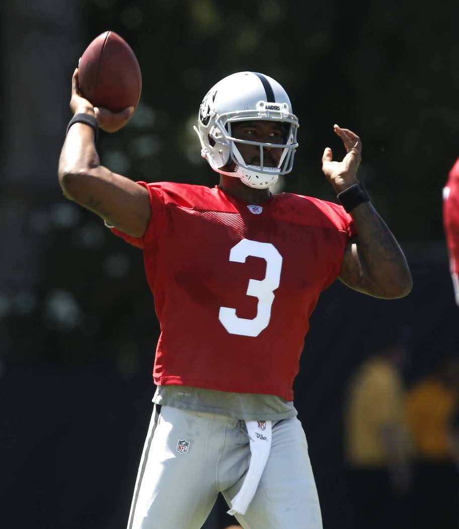 The Oakland Raiders back up quarterback Ej Manuel (3) prepares to pass the ball during the second day of teams practice at Raiders Napa Valley training complex in Napa., Calif., on Sunday, July 30 ...