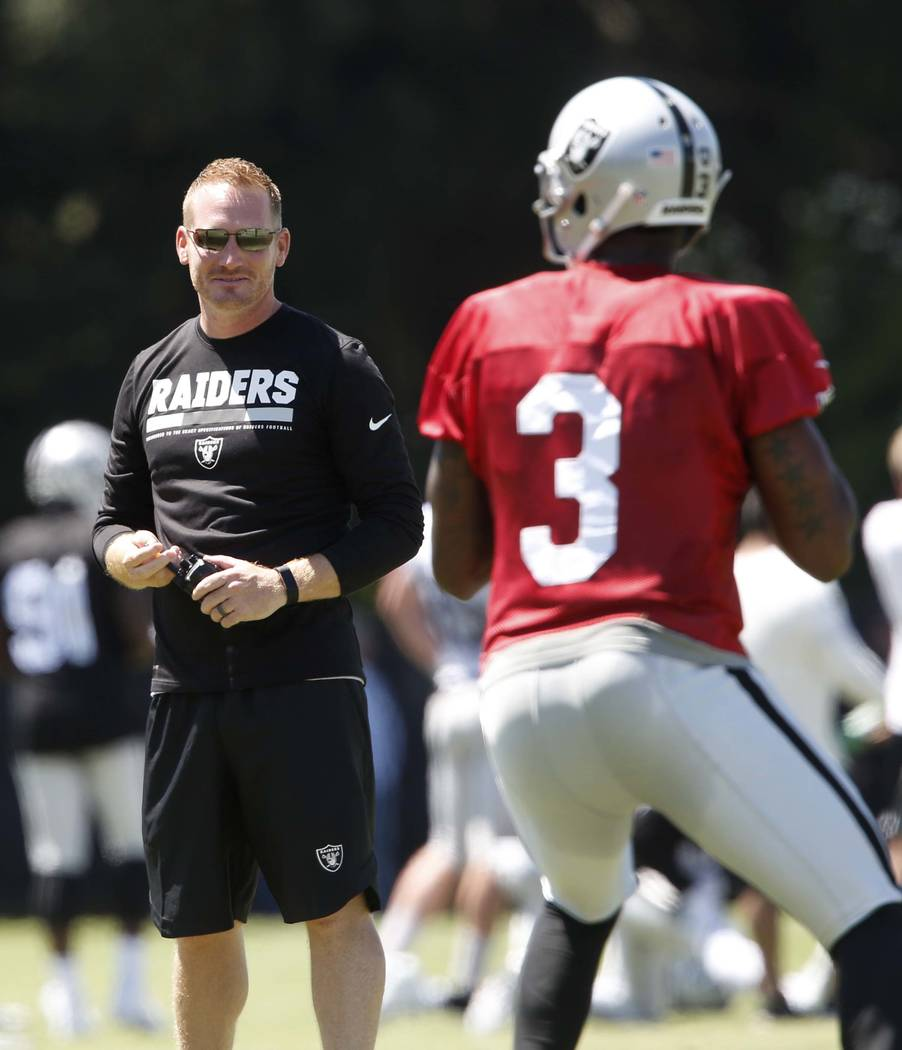 The Oakland Raiders Todd Downing watches as back up quarterback Ej Manuel (3) prepares to throw a pass during the second day of teams practice at Raiders Napa Valley training complex in Napa., Cal ...