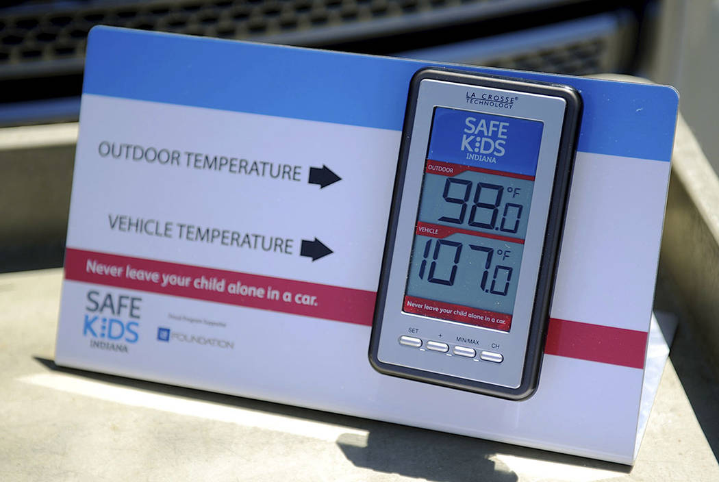 St. Mary's and Safe Kids Coalition uses a wireless monitor to record the temperature outside and inside of a closed vehicle at St. Mary's Market Days in Evansville, Ind., in 2015.  (Darrin Phegley ...