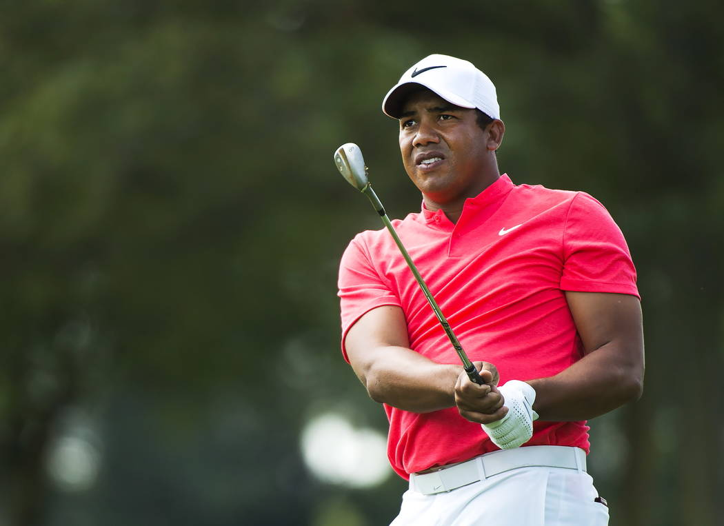 Jhonattan Vegas, of Venezuela, watches his approach shot on the 10th hole during the 2017 Canadian Open at the Glen Abbey Golf Club in Oakville, Ontario, Sunday, July 30, 2017. (Nathan Denette/The ...