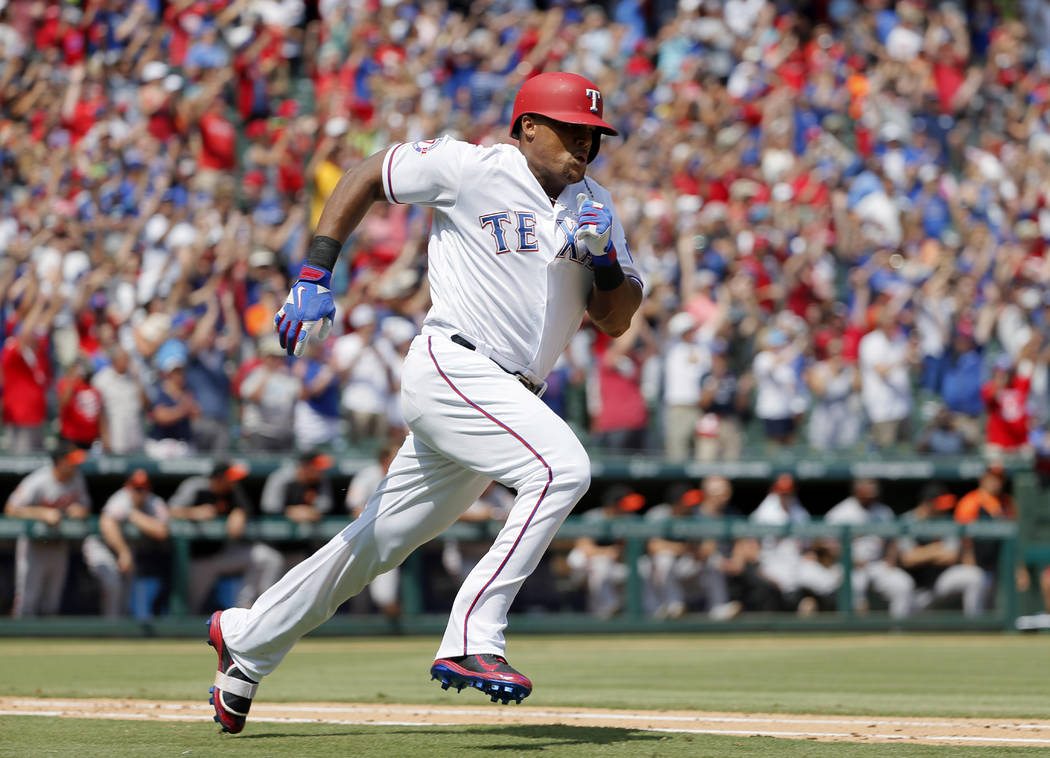 Texas Rangers' Adrian Beltre sprints around first to second after hitting for a double off a pitch from Baltimore Orioles' Wade Miley in the fourth inning of a baseball game, Sunday, July 30, 2017 ...