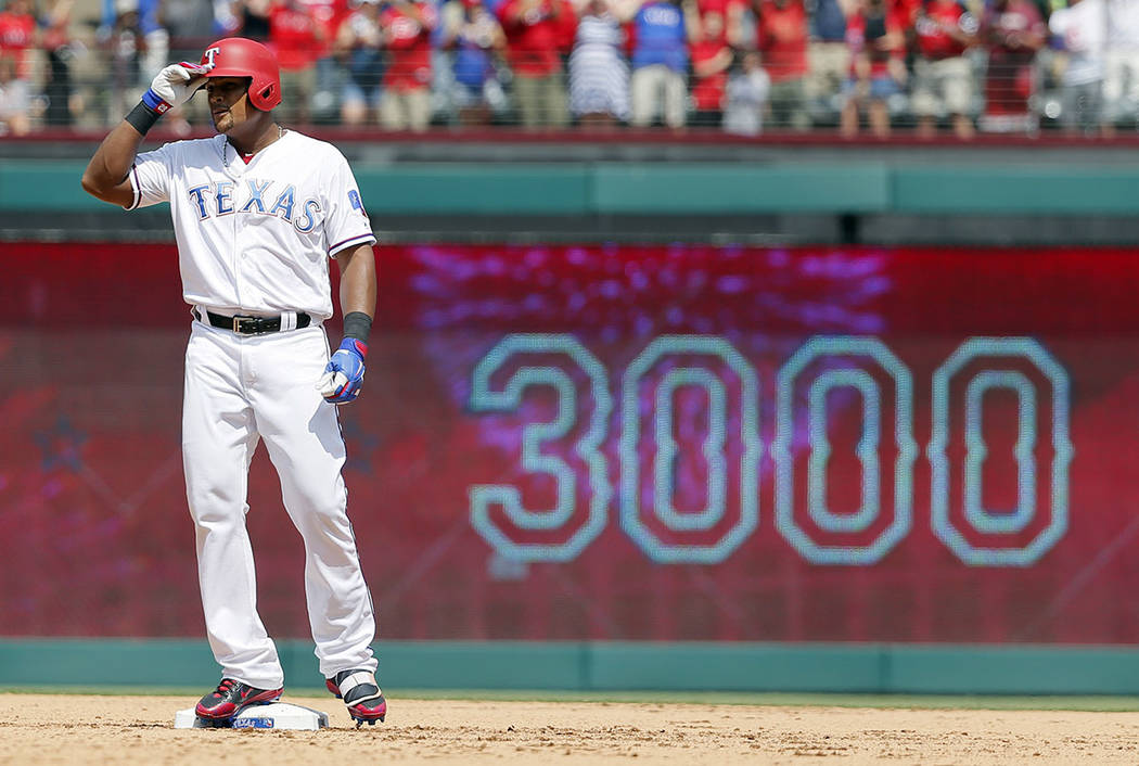 Texas Rangers' Adrian Beltre tips his helmet as he acknowledges cheers after hitting a double for his 3,000th career hit that came off a pitch from Baltimore Orioles' Wade Miley in the fourth inni ...