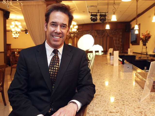 Ron DeCar poses in the bar area of the Viva Las Vegas wedding chapel catering and reception hall. (Jerry Henkel/Las Vegas Review-Journal)