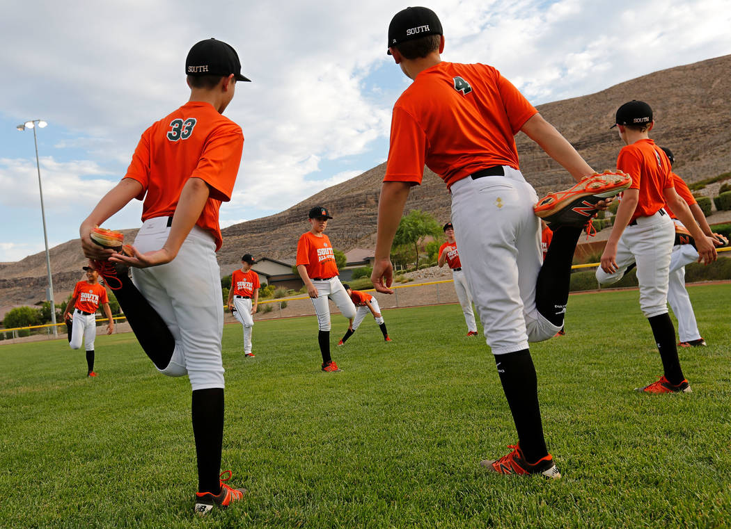 Summerlin South Little League 12U All Stars players warm up during their practice at Mesa Park in Las Vegas, Monday, July 31, 2017. Chitose Suzuki Las Vegas Review-Journal @chitosephoto