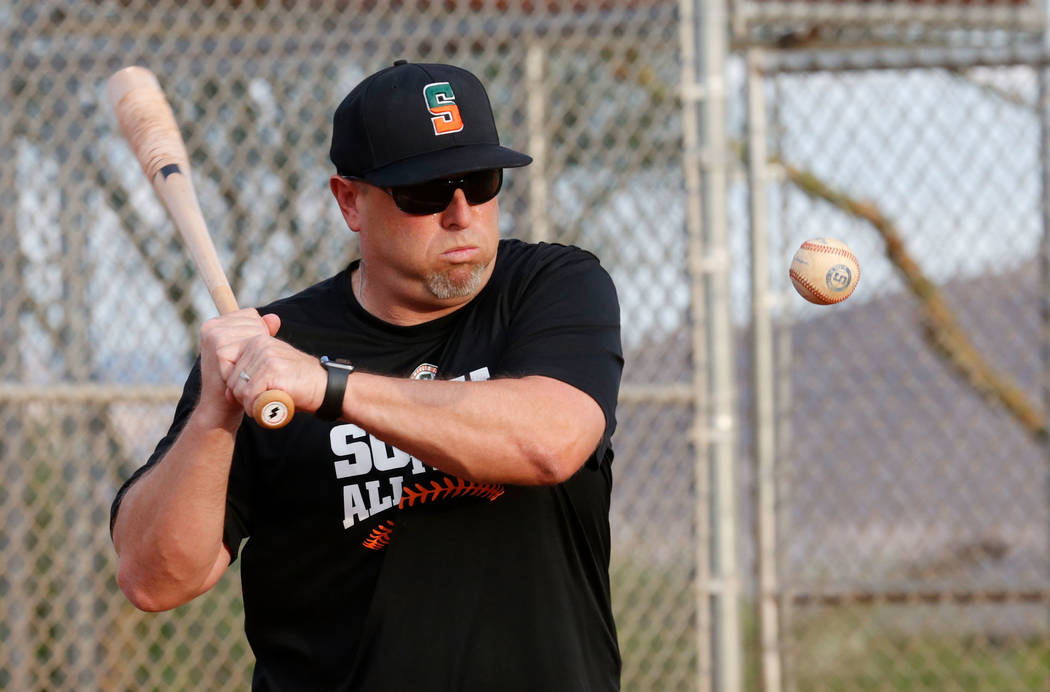 Summerlin South Little League 12U All Stars manager Adam Grant hits a ball during their practice at Mesa Park in Las Vegas, Monday, July 31, 2017. Chitose Suzuki Las Vegas Review-Journal @chitosephoto