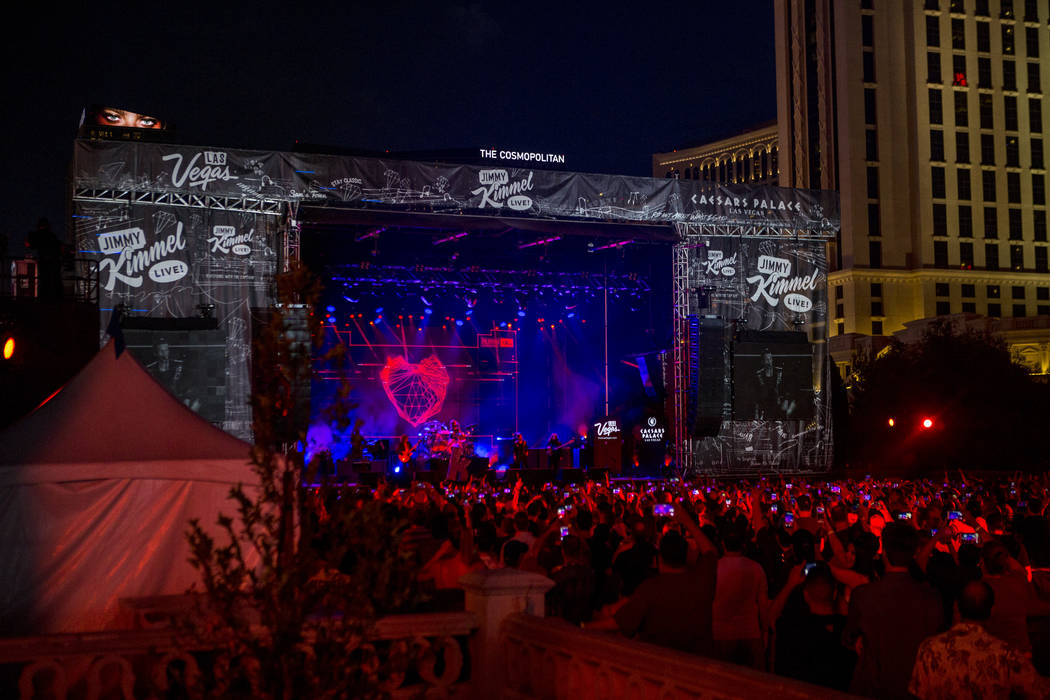 Fans pack into the area in front of Caesars Palace as The Killers perform a pop-up concert to air on Jimmy Kimmel Live! outside of Caesars Palace on Monday, July 31, 2017.  Patrick Connolly Las Ve ...