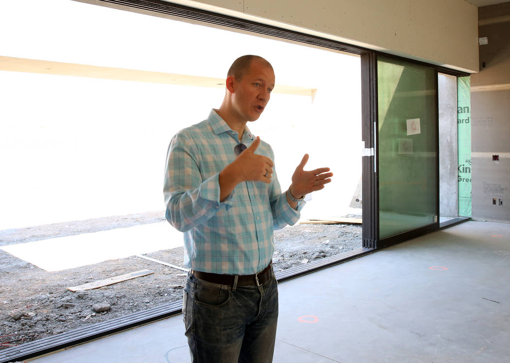 Josh Moser, project manager at Element Design, talks about the construction of an energy efficient home for St. Jude at 4135 N. Durango Drive in Las Vegas on Wednesday, July 5, 2017. Bizuayehu Tes ...