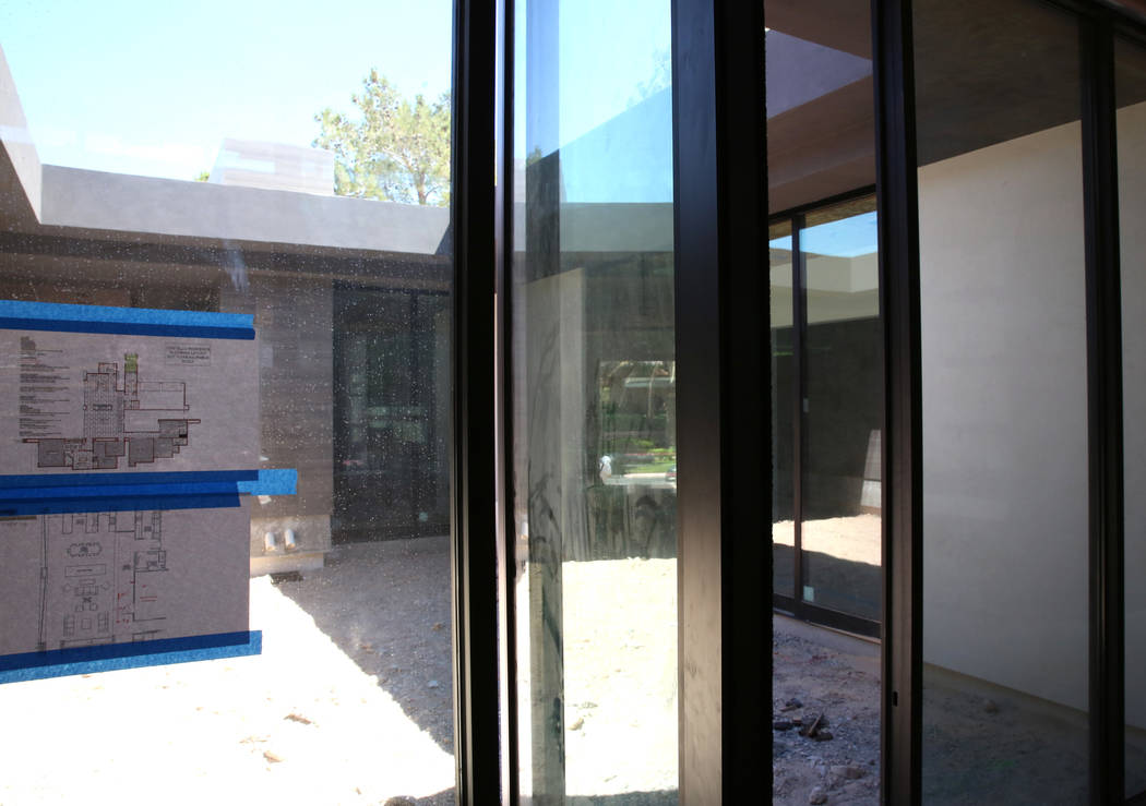 High performance glass on an energy efficient home currently under construction at 27 Burning Tree Court in Las Vegas on Wednesday, July 5, 2017. Bizuayehu Tesfaye Las Vegas Review-Journal @bizute ...