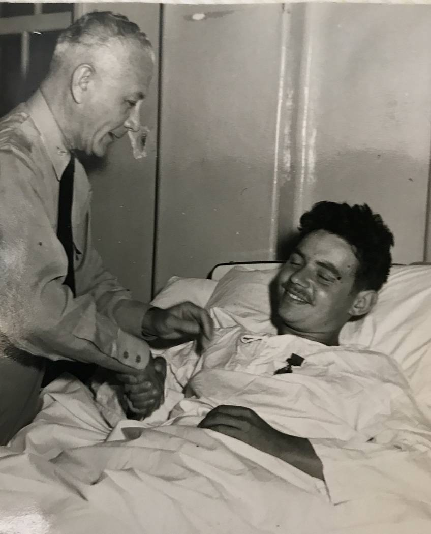 Pfc. Al Grandis,19, shakes hands with a Marine general after he was awarded a Purple Heart medal in a field hospital during the Korean War in 1951. (Navy photo)