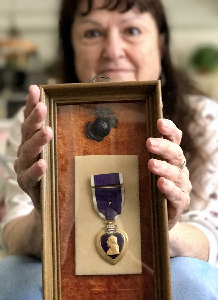 Pauline Grandis holds the framed Purple Heart medal her husband, the late Al Grandis, received during the Korean War, Tuesday, July 11, 2017, at her Las Vegas home. (Keith Rogers Las Vegas Review- ...
