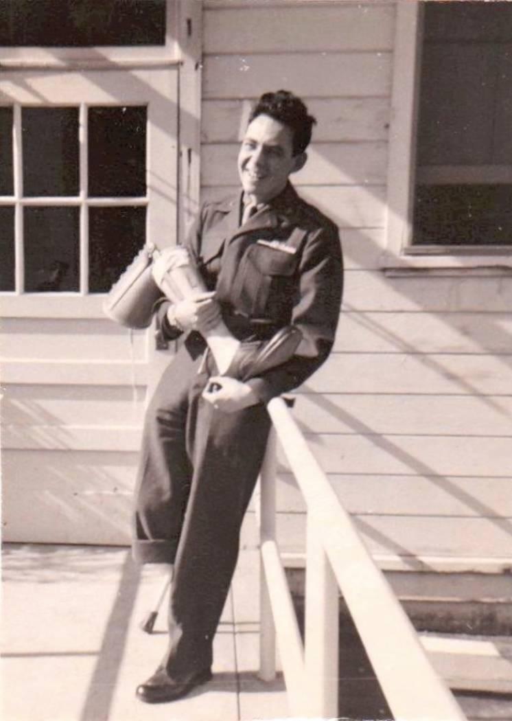Marine Al Grandis holds his prosthetic leg at Oak Knoll Naval Hospital, Oakland, Calif., in 1951. (Grandis family photo)