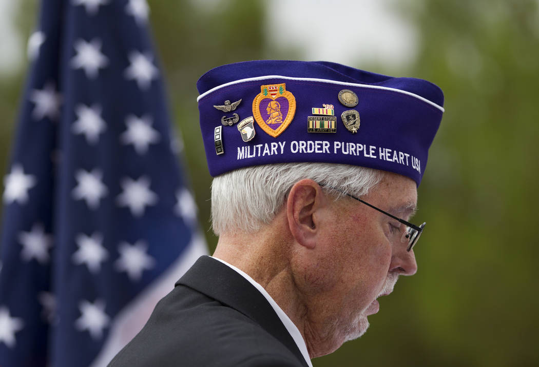 Dan Peterson, commander of the Military Order of the Purple Heart Chapter 730, during the National Purple Heart Day memorial ceremony at the Southern Nevada Veterans Memorial Cemetery in Boulder C ...