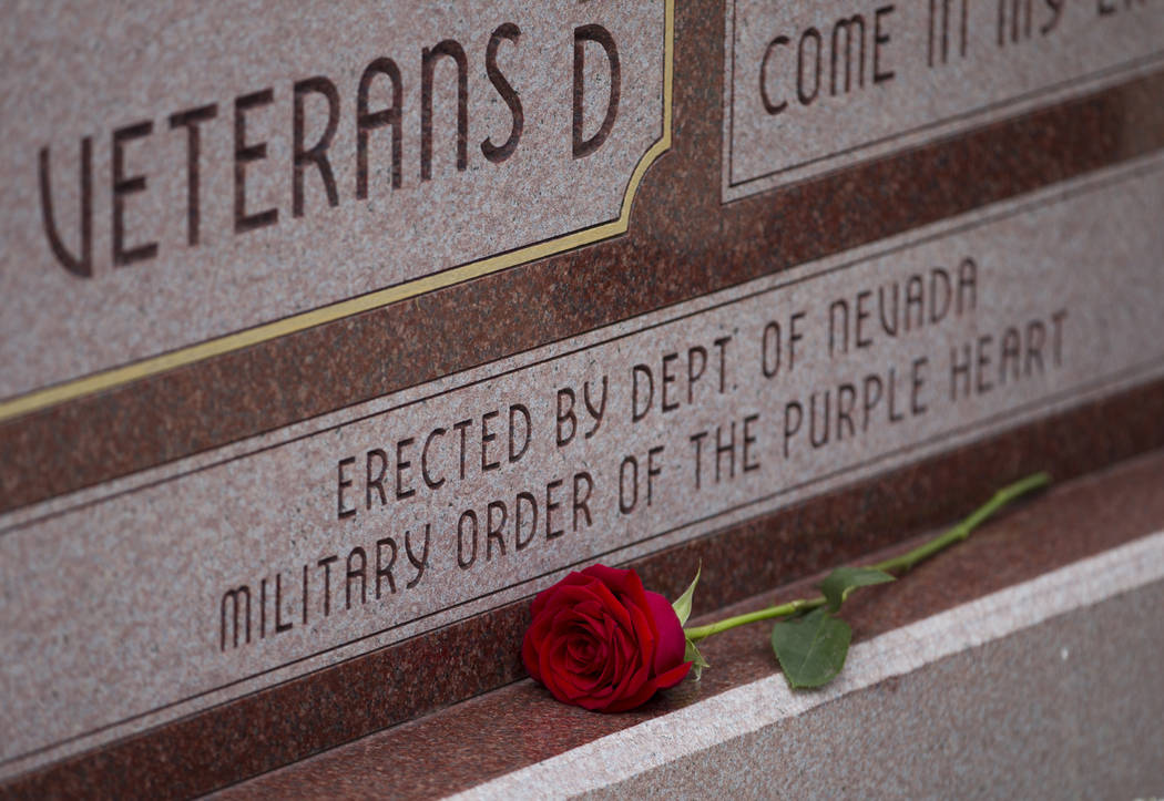 A rose during the National Purple Heart Day memorial ceremony at the Southern Nevada Veterans Memorial Cemetery in Boulder City on Saturday, Aug. 5, 2017. (Erik Verduzco/Las Vegas Review-Journal)  ...