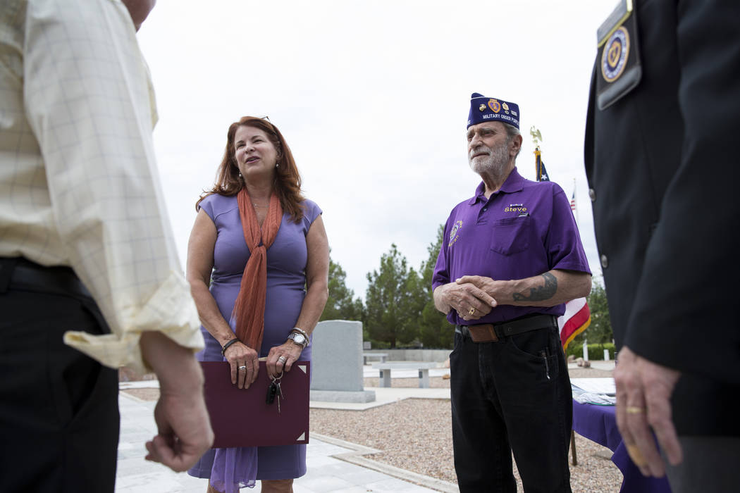 Henderson Mayor Debra March, left, and Steve Stevenson,  trustee of the Military Order of the Purple Heart Chapter 730, during the National Purple Heart Day memorial ceremony at the Southern Nevad ...