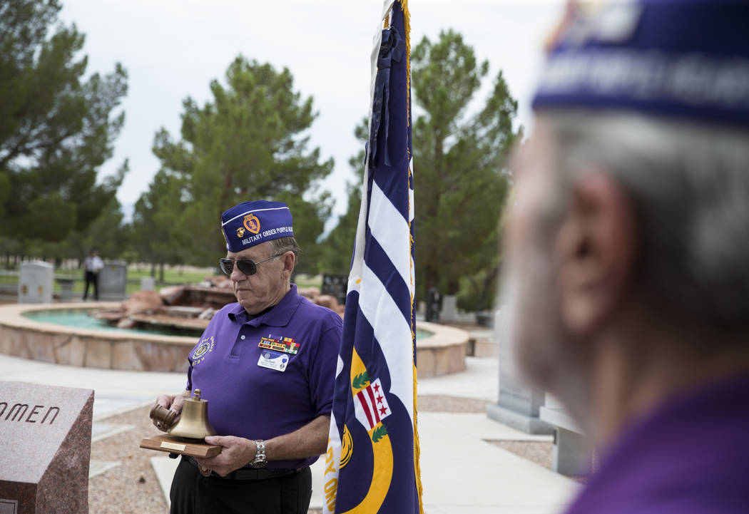 Ron Sharetts, sergeant-at-arms of the Military Order of the Purple Heart Chapter 730, during the National Purple Heart Day memorial ceremony at the Southern Nevada Veterans Memorial Cemetery in Bo ...