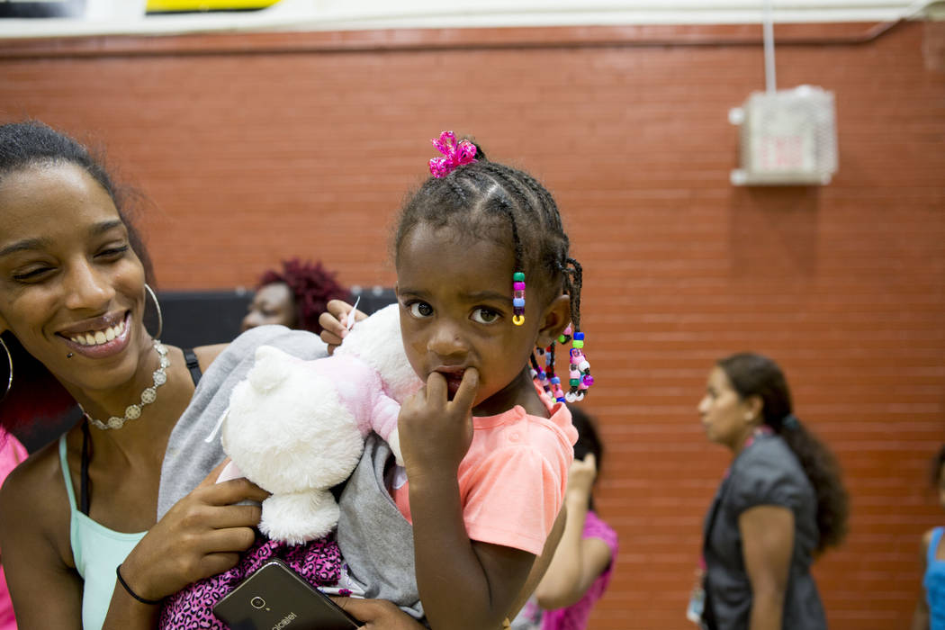 Ashley Merritt holds her daughter Alaya, 4, during the Back-to-School Fair hosted by Marianaճ Supermarkets at Clark High School in Las Vegas, Thursday, Aug. 3, 2017.  Merritt said she is gra ...