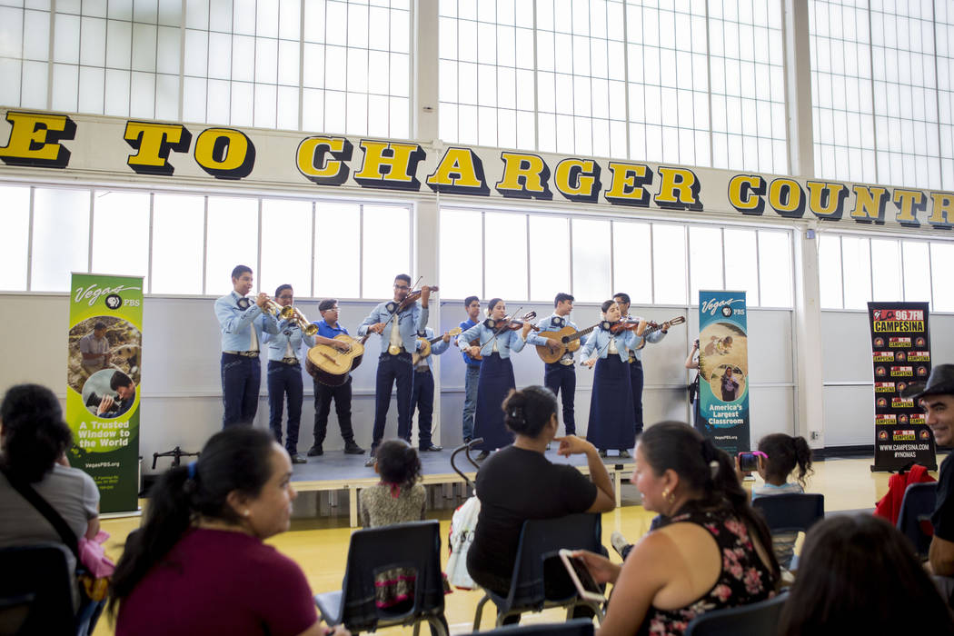 A mariachi band performs during the Back-to-School Fair hosted by Marianaճ Supermarkets at Clark High School in Las Vegas, Thursday, Aug. 3, 2017.  People waited outside for over an hour to  ...
