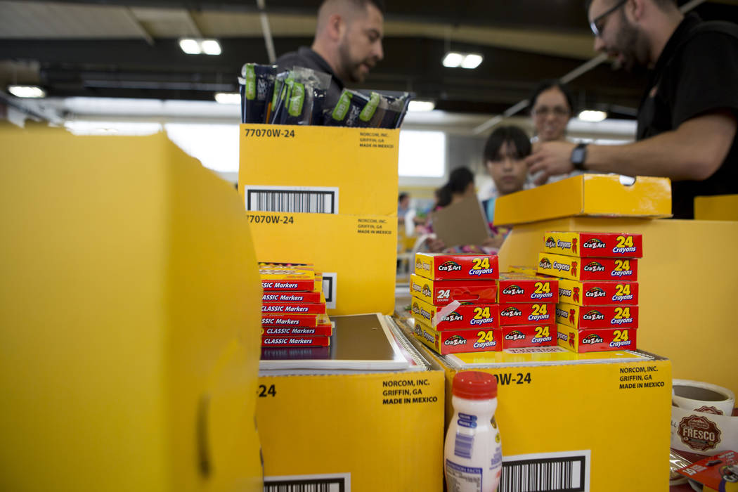 School supplies are given during the Back-to-School Fair hosted by Marianaճ Supermarkets at Clark High School in Las Vegas, Thursday, Aug. 3, 2017.  People waited outside for over an hour to ...