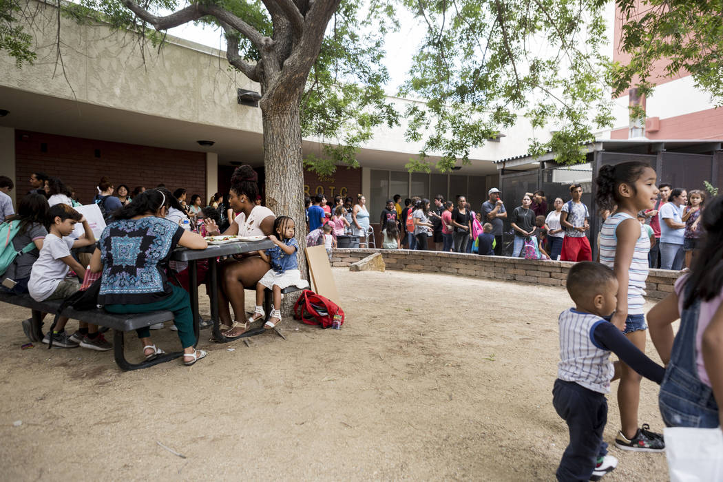 Lunch is served during the Back-to-School Fair  hosted by Marianaճ Supermarkets at Clark High School in Las Vegas, Thursday, Aug. 3, 2017.  People waited outside for over an hour to receive  ...