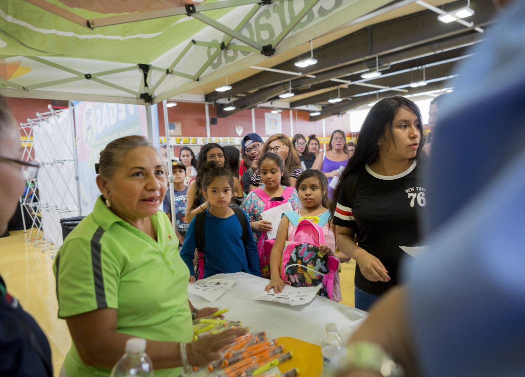 Pens are distributed during the Back-to-School Fair hosted by Marianaճ Supermarkets at Clark High School in Las Vegas, Thursday, Aug. 3, 2017.  People waited outside for over an hour to rece ...