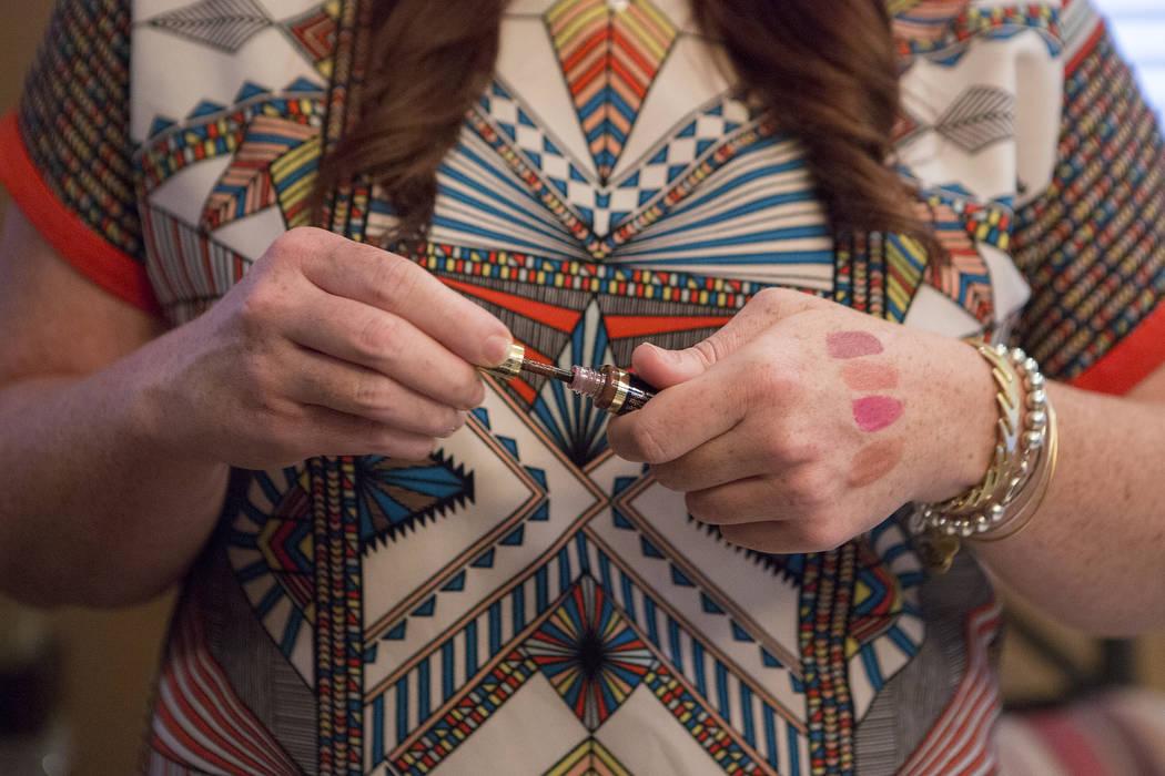 Lydia Pierce tests a SeneGence lip product during a selling party in Las Vegas on Thursday, July 20, 2017. Bridget Bennett Las Vegas Review-Journal @bridgetkbennett