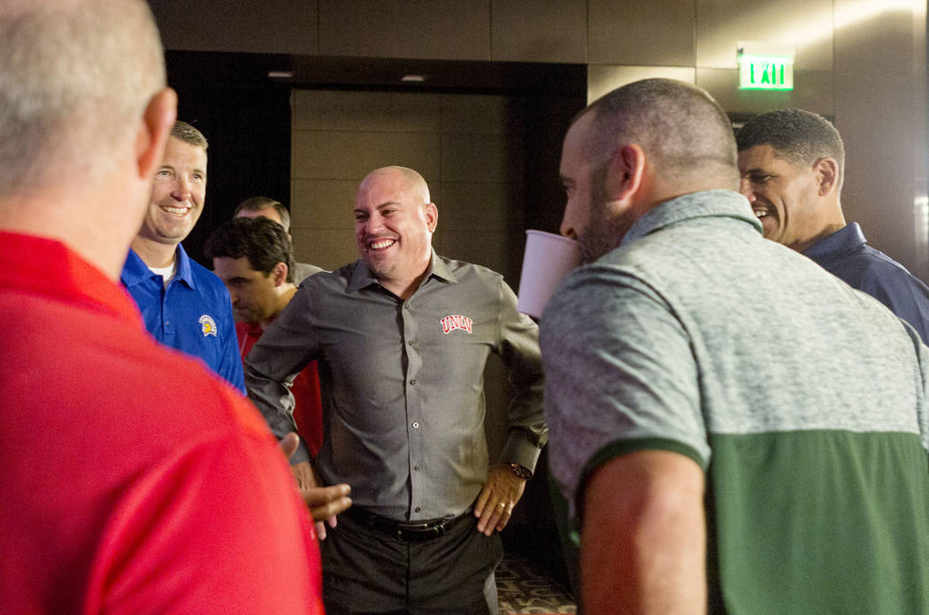 UNLV head football coach Tony Sanchez speaks with other head football coaches during the Mountain West Football Media Summit at the Cosmopolitan hotel-casino in Las Vegas, July 25, 2017. Elizabeth ...