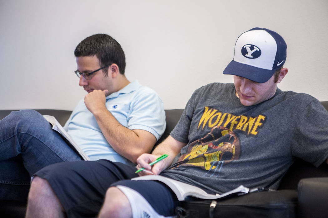Shea Billadeau, right, and Jorge Alvarez study for the Nevada bar exam while waiting to register at UNLV on Monday, July 24, 2017.  Patrick Connolly Las Vegas Review-Journal @PConnPie