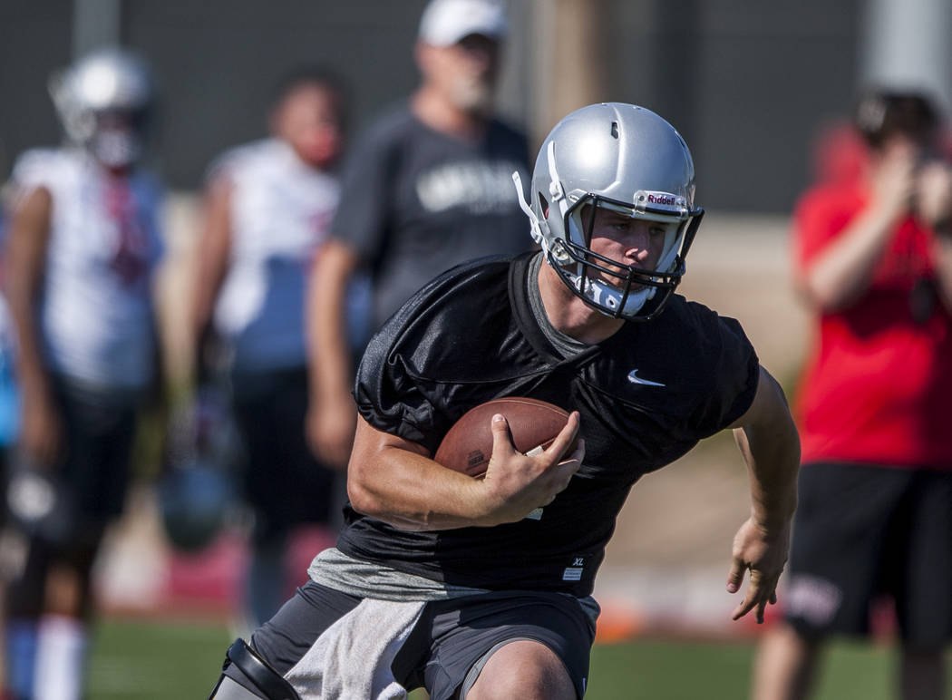 UNLV quarterback Johnny Stanton runs the ball while scrimmaging during the first day of training camp at Rebel Park on Wednesday, August 2, 2017.  Patrick Connolly Las Vegas Review-Journal @PConnPie