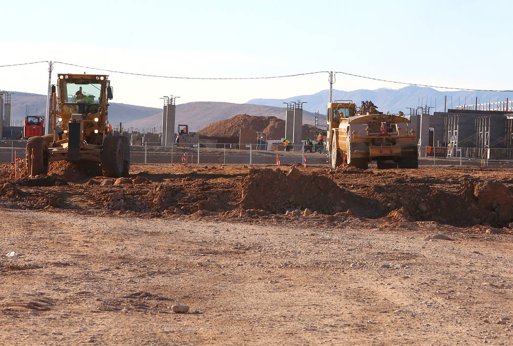 Heavy duty earth moving equipments at the site where Summerlin developer Howard Hughes Corp. has plans to build an office tower next to the new NHL practice rink in Summerlin on Tuesday, Dec. 20,  ...