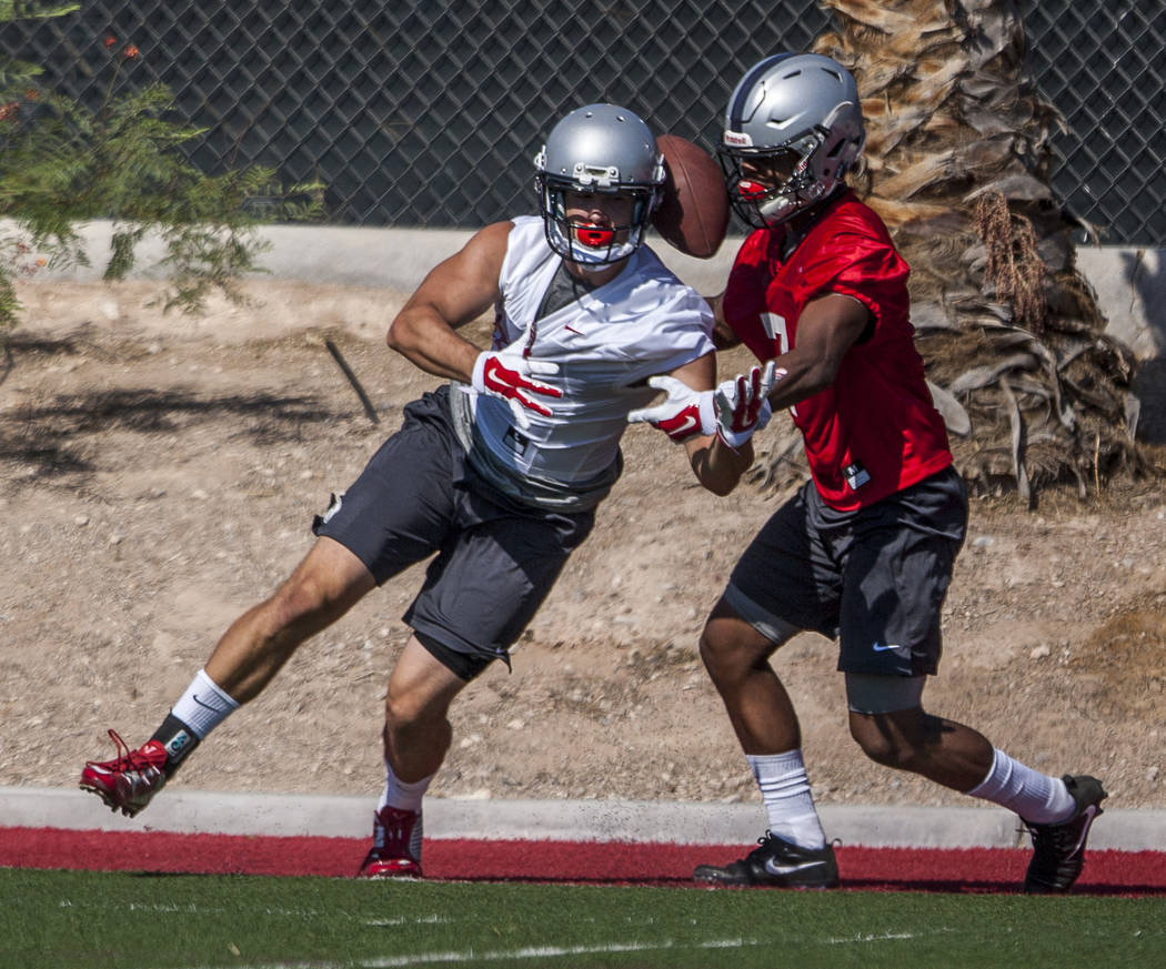 UNLV defensive back Jericho Flowers prevents wide receiver Christian Clapp from catching the balld uring the first day of training camp at Rebel Park on Wednesday, August 2, 2017.  Patrick Connoll ...