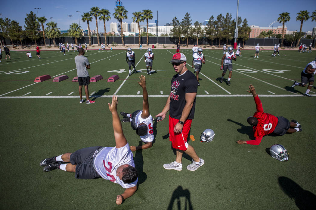 UNLV training and conditioning intern Joe Sisson works with players during the first day of training camp at Rebel Park on Wednesday, August 2, 2017.  Patrick Connolly Las Vegas Review-Journal @PC ...