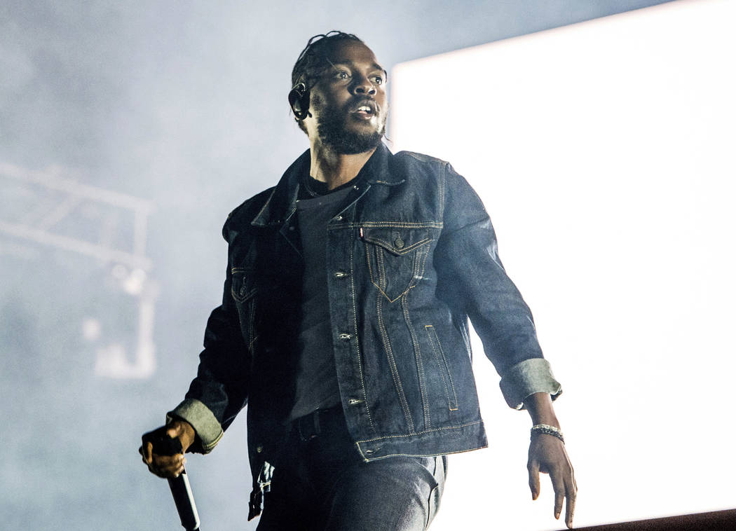 FILE - In this July 7, 2017 file photo, Kendrick Lamar performs during the Festival d'ete de Quebec in Quebec City, Canada. Lamar is the leader of the MTV Video Music Awards with eight nominations ...