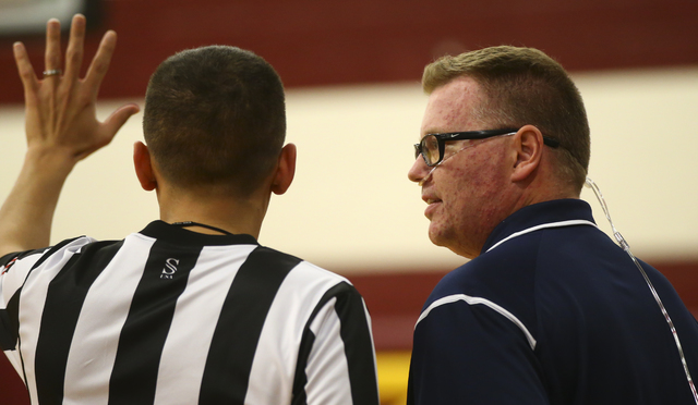 Boulder City girls basketball coach Paul Dosch talks to a referee during a basketball game at Del Sol High School in Las Vegas on Tuesday, Jan. 10, 2017. Dosch, 44, who has been coaching the team  ...
