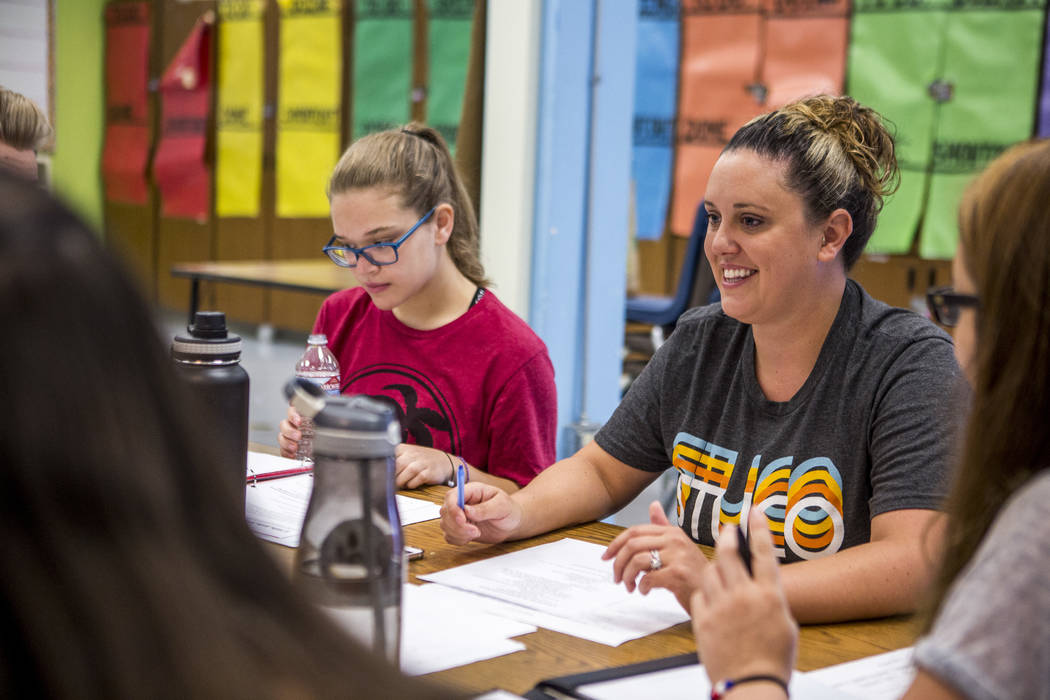 Lindsay Powers, student council advisor, smiles while going over agenda items with student council members including Daniela Cassidy, left, first vice president, at Bonanza High School on Monday,  ...