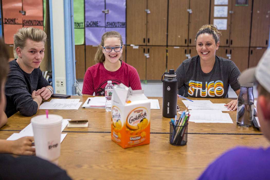 Student council members Chris Douglas, senior body president, left, Daniela Cassidy, first vice president, and advisor Lindsay Powers go through agenda items with the other council members at Bona ...