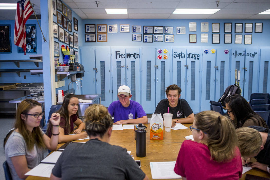 Student council members including Devon Neary, secretary, left, Maya Duckworth, sophomore class president, Justin Balconi, student body president, and James Mead, second vice president, work throu ...