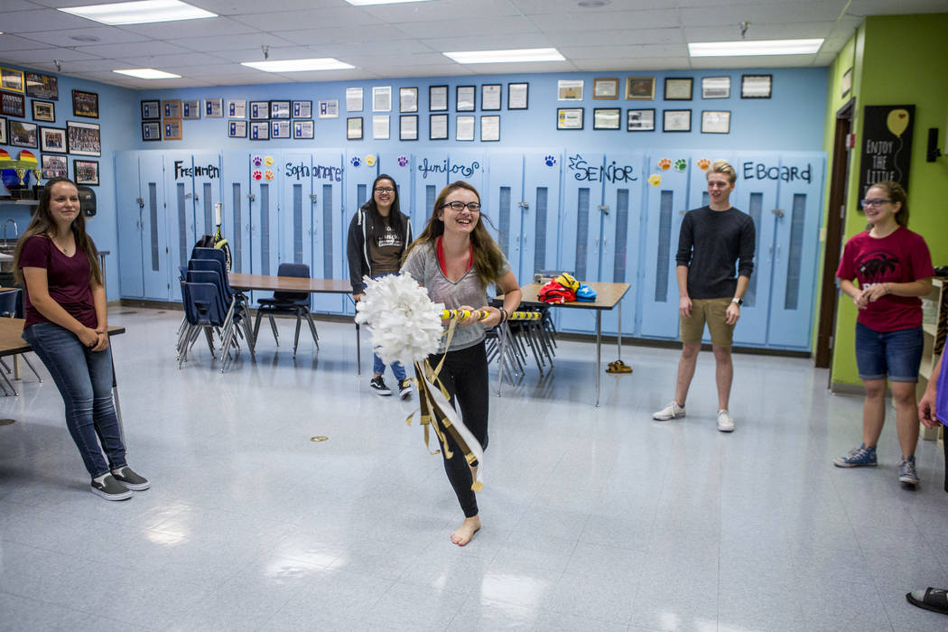 Student council secretary Devon Neary, center, prods at her fellow members with a decorative pool noodle while playing an icebreaker game in preparation for an upcoming retreat at Bonanza High Sch ...