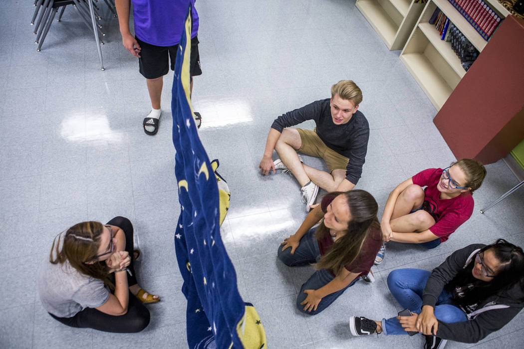 (from left) Student Council members Devon Neary, Justin Balconi (in purple), Chris Douglas, Maya Duckworth, Daniela Cassidy (in red), and Angela Lin play an icebreaker game in preparation for an u ...