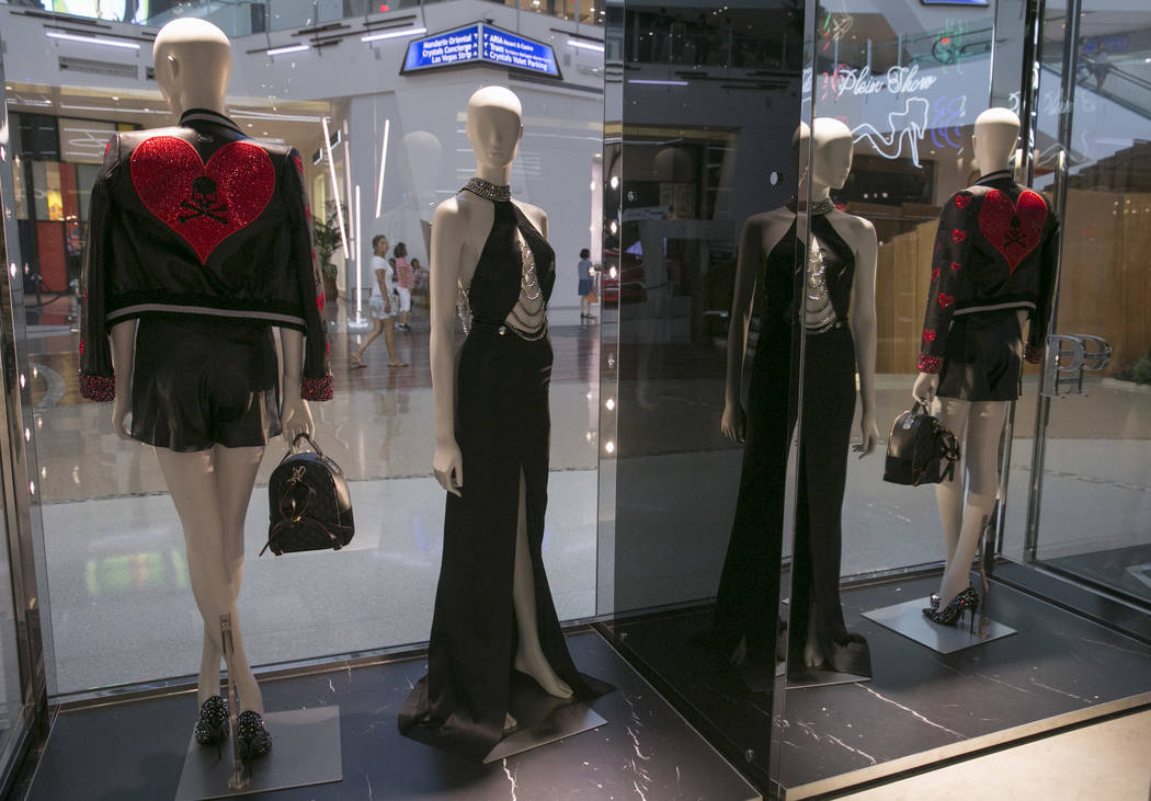 Shoppers walk by the window display at the Philipp Plein flagship store in The Shops at Crystals in Las Vegas, Thursday, July 27, 2017. Gabriella Angotti-Jones Las Vegas Review-Journal @gabriellaa ...