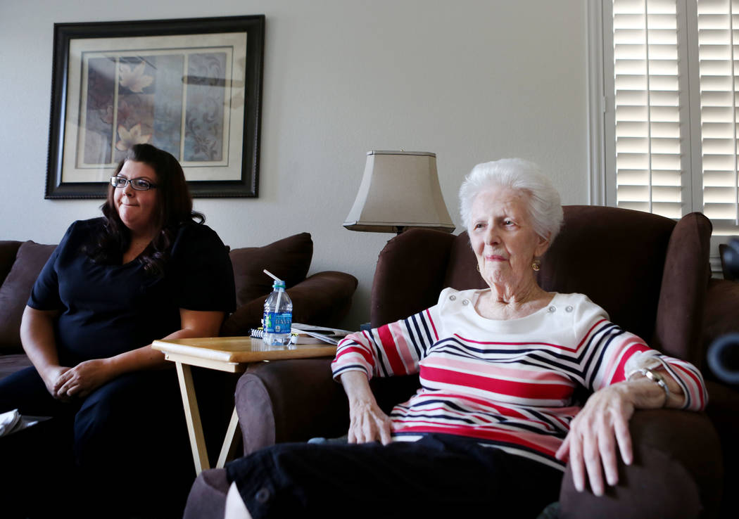 Physical care attendant Renee Nadeau, left, and Mary Jones, 88, relax in Jones' home in Las Vegas, Tuesday, Aug. 1, 2017. Jones is a client of a non-medicinal care, Golden Heart Senior Care, where ...