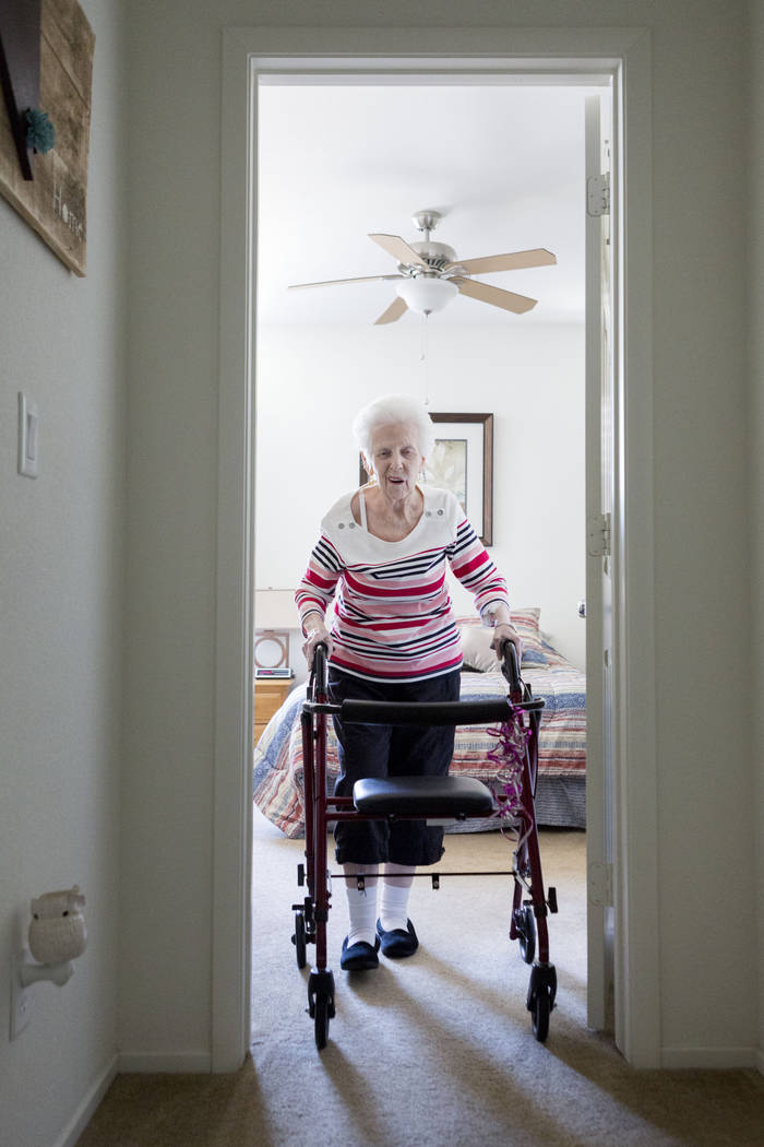 Mary Jones, 88, talks a walk as exercise in her home in Las Vegas, Tuesday, Aug. 1, 2017. Jones is a client of a non-medicinal care, Golden Heart Senior Care, where she has a physical care attenda ...