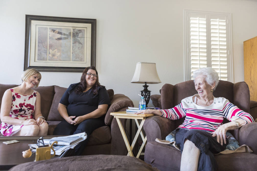Owner of Golden Heart Senior Care Christy Swadkins, left, physical care attendant Renee Nadeau, center, and Mary Jones, 88, in Jones' home in Las Vegas, Tuesday, Aug. 1, 2017. Elizabeth Brumley La ...