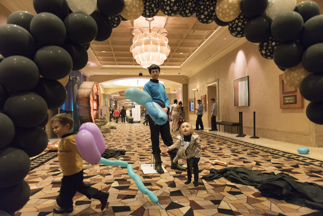 Jeff Williams, center, watches his son, Loch, 3, left, and daughter, Fable, 2, play with balloons during the Star Trek Las Vegas convention at the Rio hotel-casino Friday, Aug. 5, 2016. (Jason Ogu ...