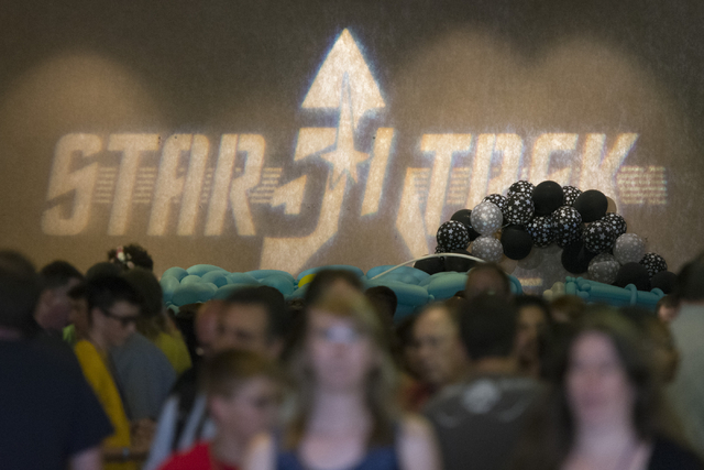 A Star Trek 50th anniversary logo is projected onto a wall above attendees during the Star Trek Las Vegas convention at the Rio hotel-casino Friday, Aug. 5, 2016.  (Jason Ogulnik/Las Vegas Review- ...