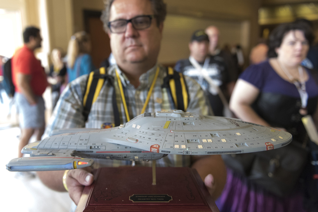 Randy Sporn shows off his Starship Voyager model during the Star Trek Las Vegas convention at the Rio hotel-casino Friday, Aug. 5, 2016.  (Jason Ogulnik/Las Vegas Review-Journal)