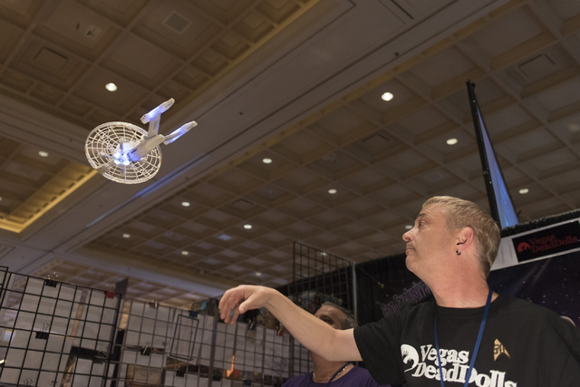 Timothy Ward launches a Starship Enterprise drone from the Vegas Dead Dolls booth during the Star Trek Las Vegas convention at the Rio hotel-casino Friday, Aug. 5, 2016.  (Jason Ogulnik/Las Vegas  ...