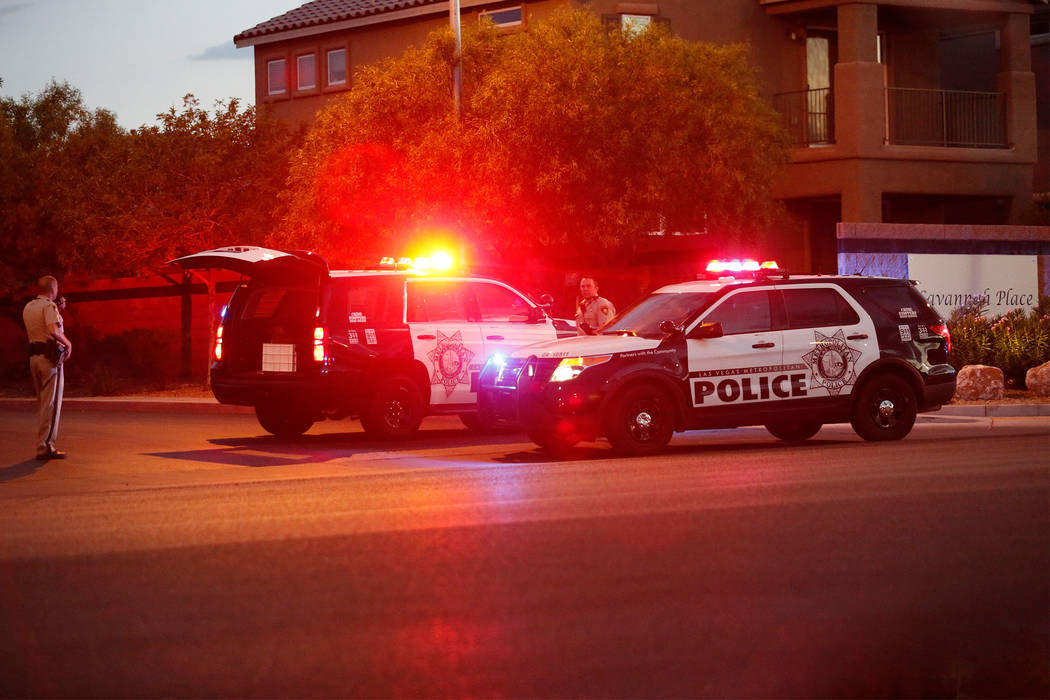 Police officers stand at the corner of West Pebble Road and South Riley Street in Las Vegas, Wednesday, July 26, 2017, after Tyler Knaub stabbed his estranged girlfriend and 4-year-old son. (Chito ...